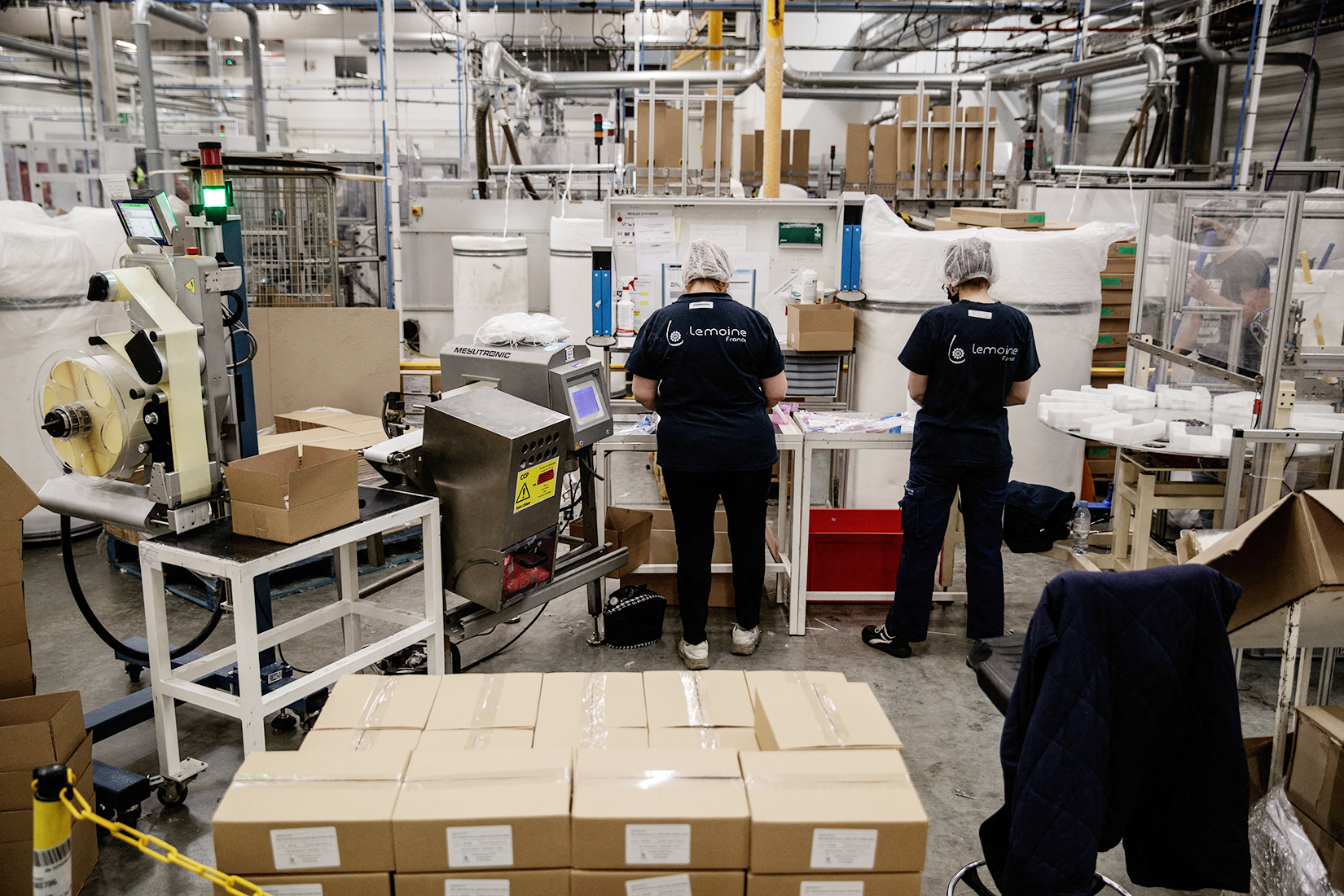 Employees of the Lemoine Group, usually producing cotton swabs, are at work on production lines rearranged to produce the nasopharyngeal swabs necessary for virological screening tests of the Covid-19, in Caligny, Normandy, on April 29, 2020, on the 44th day of a lockdown in France aimed at curbing the spread of the COVID-19 disease, caused by the novel coronavirus. (Photo by Sameer Al-DOUMY / AFP)